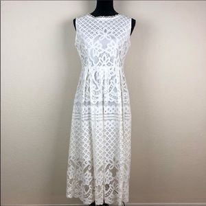 Oserjep eyelet Dress. White lined with eyelet